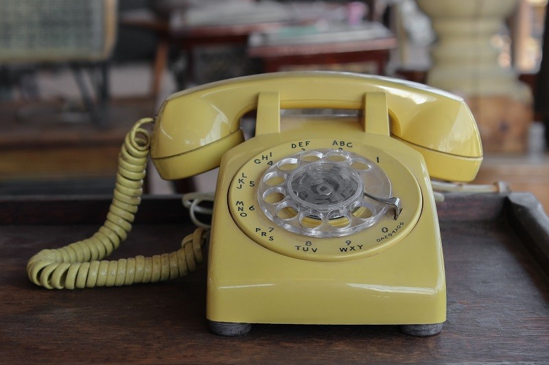 yellow old telephone
