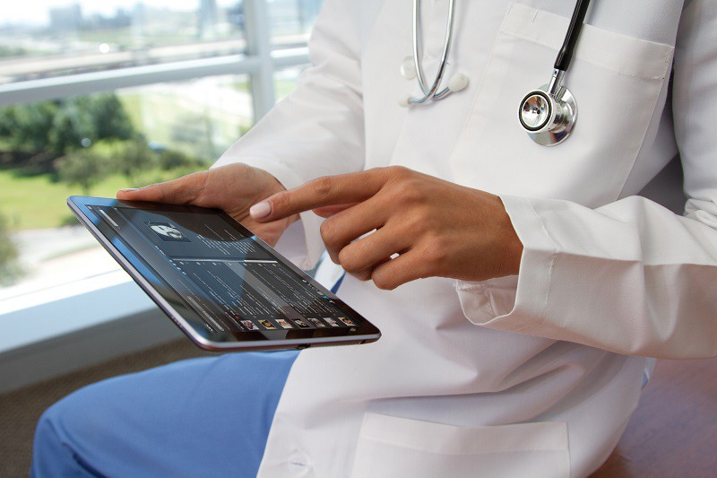 doctor browsing a tablet