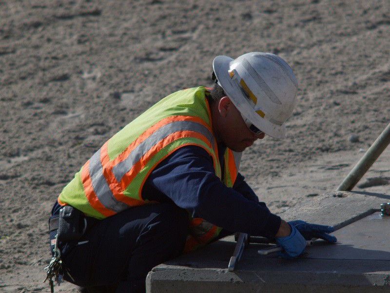 A city employee at work on the beach.